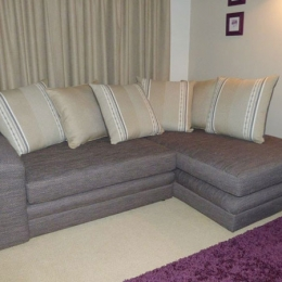 Re-upholstered corner sofa