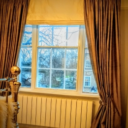 Silk curtains & brass pole